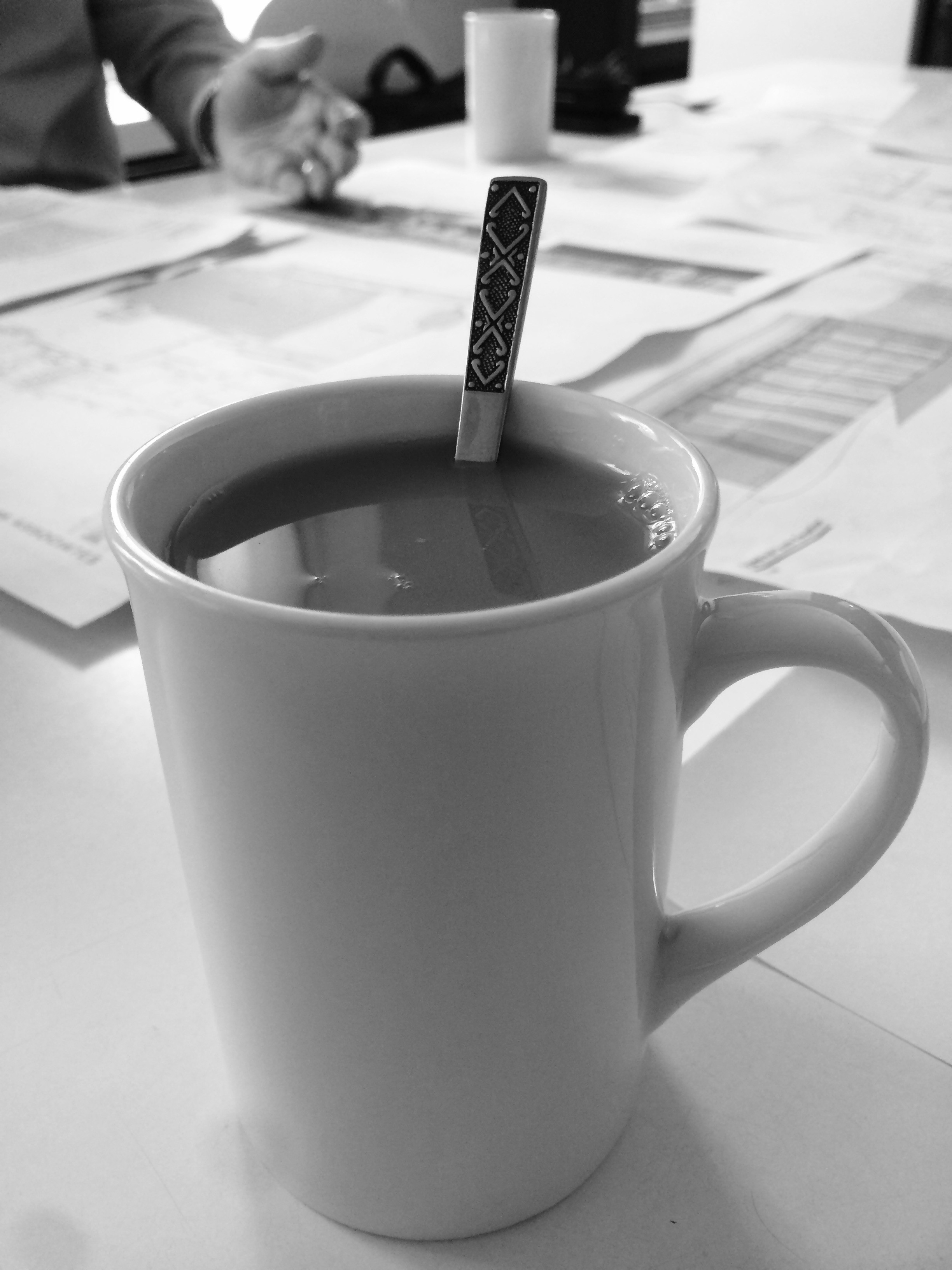 image of a cup and plans